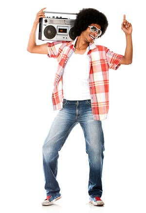 Funky man listening to music on the radio - isolated over a white background