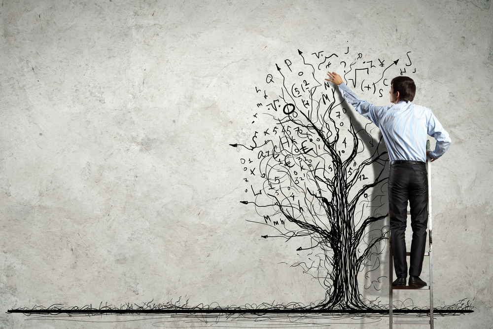 Man on ladder drawing tree to illustrate business growth