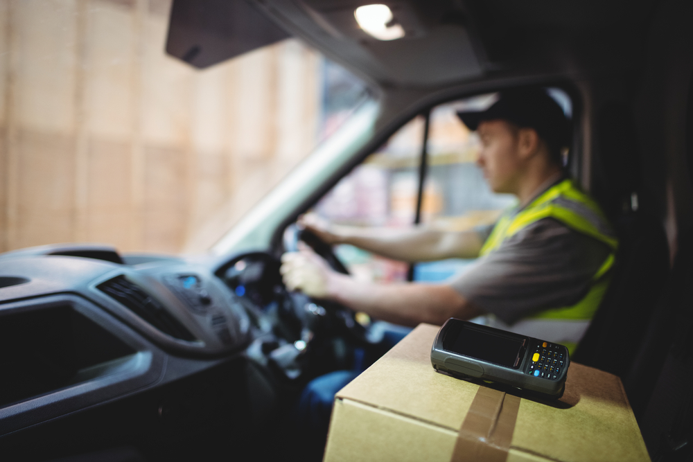 Delivery truck driver with box of apparel