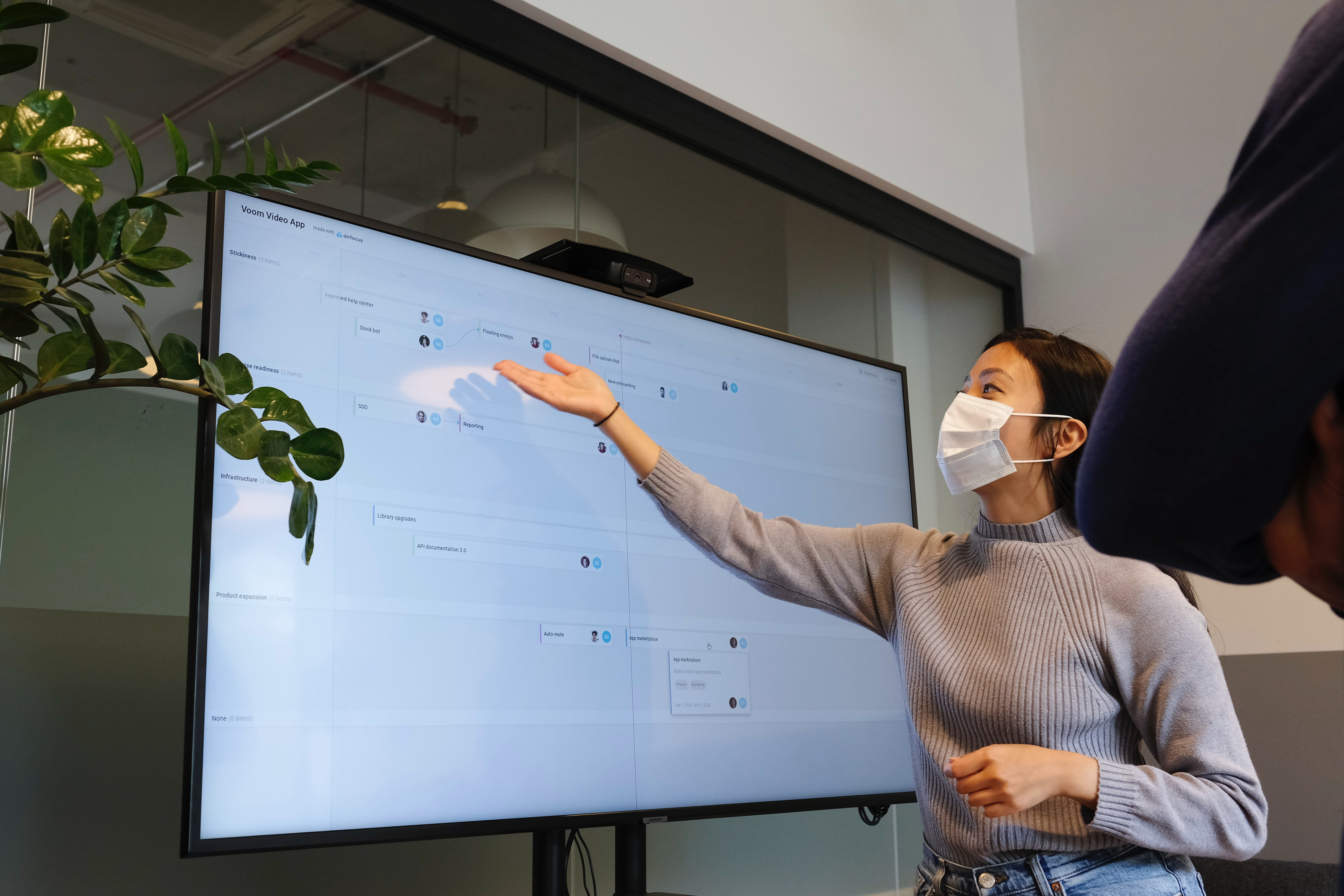 Woman pointing at the screen of her work presentation